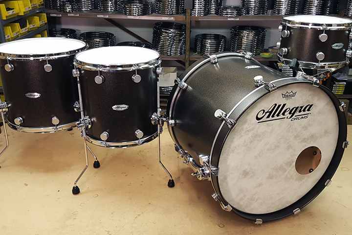 Allegra Drums Master Craft Kit in Black Sparkle. Drum Sizes: 22 x 18 Bass Drum, 12 x 7 Rack Tom, 14 x 14 Floor Tom, 16 x 14 Floor Tom.